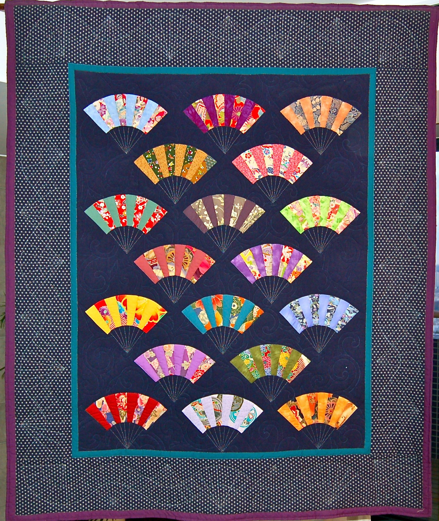 Japanese Fan Quilt http://tokyojinja.com/2011/03/06/coming-full-circle-a-history-of-the-asij-gala-quilt/