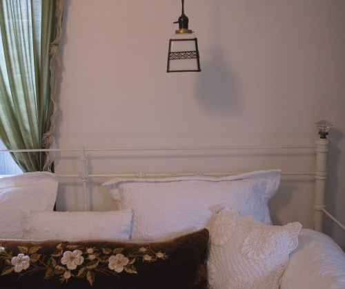 vintage milk glass fixture in guest room
