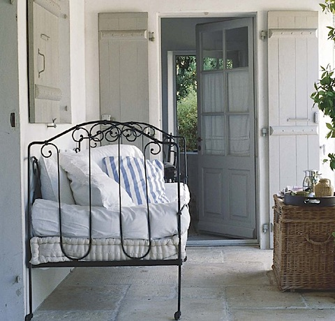 porch with iron bed