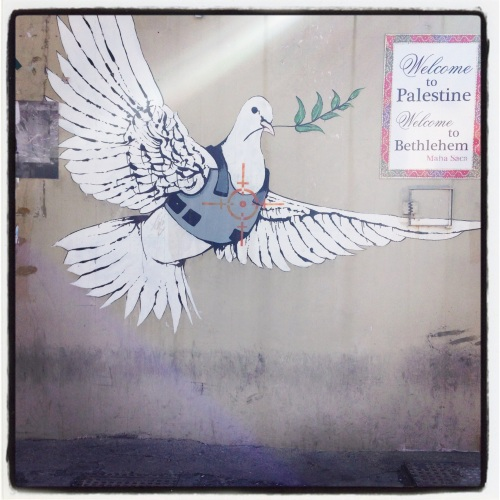 Banksy armored vest peace dove